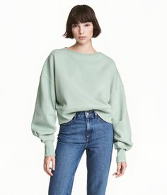 Mint green. Short, loose-fitting sweatshirt. Wide neckline, dropped shoulders, long, pleated sleeves, and wide ribbing at cuffs and hem. Soft, brushed