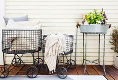 These laundry baskets are used as holders of pillows and throws so guests can get comfortable on the porch.