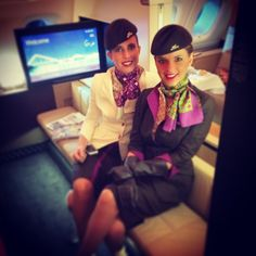 Etihad Airways Stewardesses. I had to take a photo of these beautiful young women, who rescued me from the drunk and obnoxious yob sitting next to me. He was aggressive and unpleasant. Julie (left) noticed and warned him to stop. He got worse, but without warning, Julie and her colleague Helen (right) swept in, pulled him to his feet before he knew what was happening, bound his wrists and bundled him to the back of the plane. You wouldn't know it to look at them.