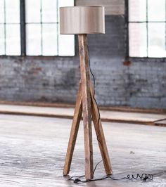 Constructed from reclaimed, weather-worn elm wood, this lamp's tripod of soft-sheen, hand-hewn pillars merge beneath a fabric shade bulb. Eclectic Floor Lamps, Rustic Floor Lamps, Wood Floor Lamp, Black Floor Lamp, Wood Lamps, I Love Lamp, Fancy, Fabric Shades, Lamp Shades