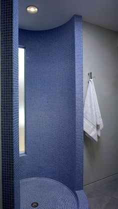 Rounded Shower. 1x1 Mosaic in a single colour contour the wall and floor. #tile #shower #bathroom