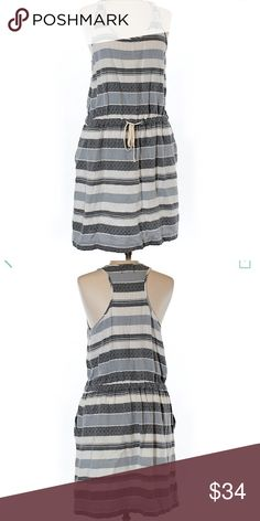 """Lou & Grey casual t-back knit dress Perfect for summer! A casual dress or even a swim coverup. This Lou & Grey soft knit dress has a racerback/t-back backside, front pockets and an adjustable drawstring at waist. Very comfortable! 30"""" length and 34"""" chest. In ✨excellent condition! ✨ Lou & Grey Dresses"""