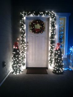 I wanted a simple yet classy look for my front porch without breaking the budget. Tomato cage trees are wonderful for recycling my garden tomato cages! I used two four foot tomato cages, 6-7 nine foot long garlands from the dollar store and 1 set of 100 strand white lights for each tree! I then tied a bow of ribbon to the top and Wah-la! I was very happy with this.