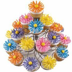 "Puffed-Up Petals Cupcakes. It's a delicious dessert that doubles as a beautiful ""floral"" centerpiece. Make fondant flower petals ahead of time and assemble the day of serving."