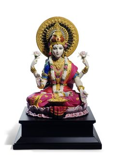 Lalitha Devi means: The Goddess who plays (with the creation, her children) She also represents Durga, Lakshmi, Sarasvati – all aspects of the Mother Goddess in One. She is loving & compassionate with her children and grants their wishes – if it is good for them !