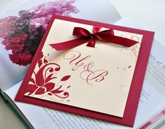 Weddin invitation with simple  ornament and dark red ribbon + red liqueur envelope