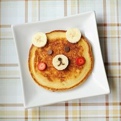 Cute bear pancakes with bananas strawberries, & choco chips