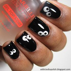 Spooky Eyes in the Dark Halloween Nail Art | Addicted to Polish