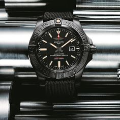 The @breitling Avenger Blackbird features a 48-mm case made of lightweight-but-robust titanium and coated with a carbon-based treatment and extra-large hands and hour markers treated with luminescent coating; the automatic movement, Breitling Caliber 17, is COSC-certified as a chronometer. #breitling #watchtime #pilotswatch