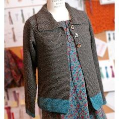 """Our Sawtelle Adult cardigan is made entirely of knit sts and the only seaming is at the shoulders. It's the grown up version of our popular Sawtelle, for girls. Finished Measurements: Chest (closed) – 32(36-40-44-48-52)"""" Length – 21½(22-23-23½-24½-25) Yarn: 4(5-5-6-7-8) Balls Berroco Remix #3967 Bittersweet (MC) and 1 ball #3984 Ocean (CC) Needles: Two 24"""" length circular knitting needles, size 8 (5.00 mm) Gauge: 17 sts = 4""""; 32 rows = 4"""" in Garter St 17 sts = 4..."""