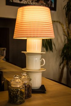 Take IKEA Hemma lamp, old porcelain cups and after drilling them put everything together! It looks very nice!