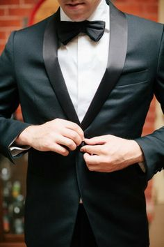 Classic example of why a navy tuxedo is superior—it doesn't take on a greenish tinge under artificial lighting.