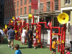 The Imagindation Playgrounds sound garden full of red piping materials with yellow horns to create various noises