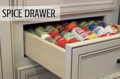 spice drawer - way better than a tall, lower pull out spice cabinet. No bending down!!!!by Village Home Stores