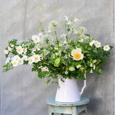 Summery floral arrangement in a white pitcher