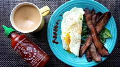Link in bio#thatchillaxdude  Breakfast for lunch...  #followyourarrow #travel  #wandern #travelbug #travelgram #wanderlust #notallwhowanderarelost #instalike #instatravel #instatraveling #photography #holiday #tourism #followme #travelblogger #passportready #worldtravel #natgeo #love #wander #instafood #foodporn #breakfast #brunch #eggs #bacon #fiestaware #sriracha #coffee
