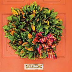 54 Festive Christmas Wreaths: Magnolia Wreath with Plaid Bow