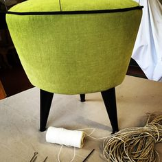 Acid green fabric with black trim and blacks lacquered feet.Handmade in italy