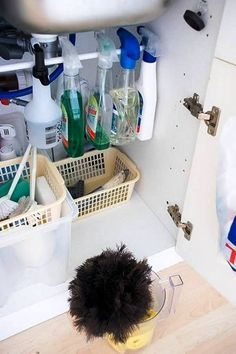 Cleaning Supplies Another great use for a tension rod.under sink storage for cleaning supplies! Organisation Hacks, Kitchen Organization, Kitchen Storage, Storage Organization, Storage Spaces, Storage Ideas, Organizing Ideas, Organized Kitchen, Cabinet Storage