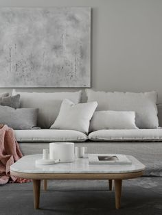 cosy yet minimal living room with a light, tonal colour scheme   this model home was styled by Pella Hedeby for JM   &tradition wood and marble coffee table   IKEA Söderhamn sofa with a Bemz Loose Fit Urban cover in Unbleached Rosendal Pure Washed Linen
