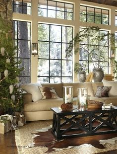 Pottery Barn Living Room.  Except for the coffee table, this is my dream living room - big windows, cowhide rug and pillows - casual elegance.