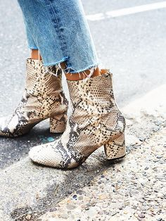 Snake skin leather ankle boots with block heels and frayed denim