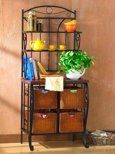 Beauty meets function in iron and wicker. Do you dream of having a more organized kitchen? Take advantage of the spacious Iron/Wicker Storage Baker's Rack. It's just as beautiful, as it is functional. Think of it as your personal organizing system with shelves and roomy wicker drawers. This simple and stylish baker's rack solves your kitchen storage worries, so you can focus on your cooking!