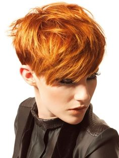 Beautiful vibrant colour accentuates the texture in this short but feminine haircut