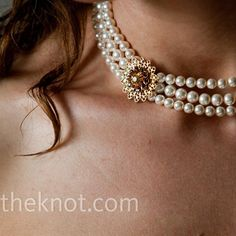 The making of an heirloom: Via the Knot.com-Nicola wore a three-strand pearl necklace, which she made with her mom specifically for the wedding.
