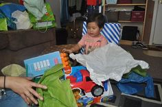 Opening his birthday gifts