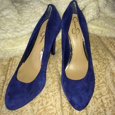Blue suede pumps with 4 inch heel  Blue suede pumps with a 4 inch heel. Worn once. Only damage is some wear on inside heels of shoes (see pic) and a black mark on one shoe that you can't really see (see pic) from storage. No size on them but I think they're a 7. No trades thanks! Jessica Simpson Shoes Heels
