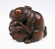 Netsuke de madera de un perrito Koken