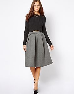 cute little outfit  Pleated long skirt and Crop sweater. But I'd wear it with a non-cropped shirt!