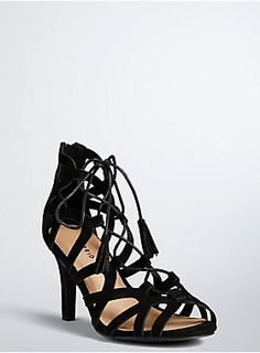 "<p>There's definitely a long night of dancing in your future if you snap up these heels. The black faux suede masters sex appeal with a scalloped cutout front that's held in place by ultra sultry lace up ties.</p>  <ul> 	<li>3.5"" heel</li> 	<li>Man-made materials</li> 	<li>Imported</li> </ul>"