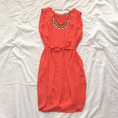 NWOT Bright Red Sleeveless Dress Such a cute fiery red dress! This dress is loose fitting, but has a sash to tighten the waist. The back had a small key hole enclosure. The dress is 34 inches long Forever 21 Dresses