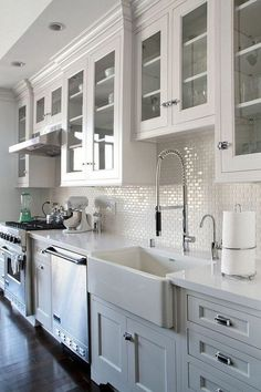 like the white sink and white cabinets and the dark wood floor. Don't prefer the mini subway tiles