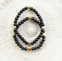Black beaded stretch bracelet, gold vermeil charms, Hamsa charm, elephant charm