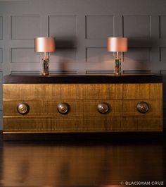 by Damian Jones  studded brass, walnut, antiqued mirror, glass shelves  35.5