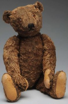 Early Steiff Mohair Teddy Bear. Brown mohair with center seam face, long snout, brown glass eyes, sewn black nose and mouth.