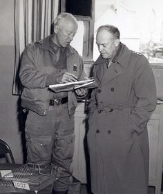 Patton and Eisenhower working out the seating arrangements for dinner