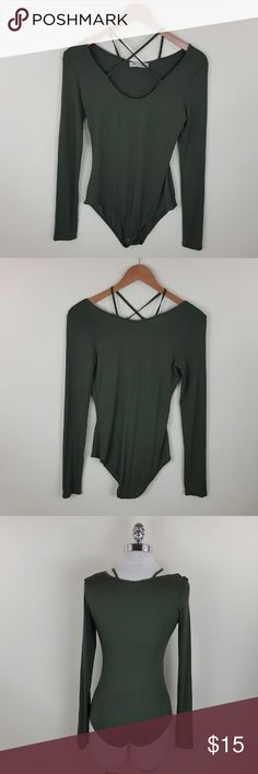 Olive strappy bodysuit Olive strappy bodysuit  Strappy long sleeve olive bodysuit  Content 95% rayon 5% spandex Tops