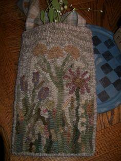 A hooked rug pocket I just finished.  Hooked on Primitives