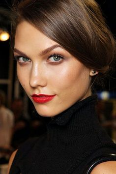 Dewy bronzed skin looks gorgeous with a warm coral-leaning red.