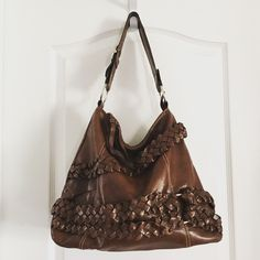 "Aldo Oversized Hobo Bag Aldo Faux leather hobo bag  ·         Very large ·         Zipper closure ·         Braided detail on front ·         Interior zip pocket ·         Interior slip pockets ·         Measures 15""x4""x13"" ·         Strap 9"" ALDO Bags Hobos"