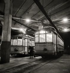 "April 1943. ""Baltimore, Maryland. Trolleys inside the Park Terminal at night."" Photo by Marjory Collins for the Office of War Information"