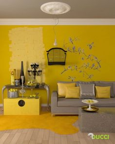 Half of my relatives would look dead in this room . . . but SO GREAT. Yellow and gray - murals and birdcage. Love it.