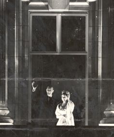 Later in the evening, Queen Elizabeth and Prince Philip made several appearances in the windows of Buckingham Palace much to the delight of the cheering crowds outside. This photo was taken from their third window appearance that night.