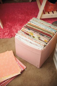 There's a lot of crafts organizing on this page, put this very picture cached my eye. An Ikea box as hanging folder stand. (Or whatever it is in English ;)