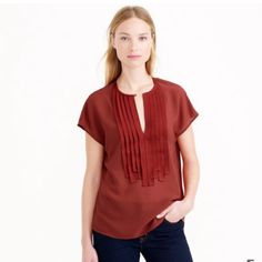 """J.Crew Grosgrain Top T26-A placketnof layered ribbons flutters around a sweet keyhole neck for a top that's pretty as it is versatile. Polyester. Cap Sleeves, front keyhole with button closure. Flat across @ Bust: 20"""", Flat across @ bottom hem: 20"""", Top shoulder to bottom hem: 25"""". (it fits like Meduim or Large) Available color: Cream & Navy Blue. NWOT J. Crew Tops Blouses"""