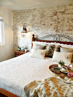 Bedroom makeover using faux brick panels in red and then whitewashing them!